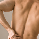 a man with back pain and sciatica